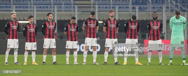 Milan players participate in a minute silence in memory of the deceased Italian former player Paolo Rossi prior to the Serie A match between AC Milan...