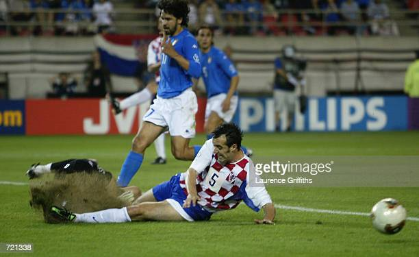 Milan Rapaic of Croatia brings up the turf during the FIFA World Cup Finals 2002 Group G match between Italy and Croatia played at the...