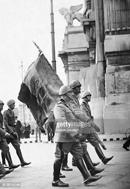 Milan regiments march in formation, carrying flags out of Milan to the Piave River during, the 20th anniversary celebrations of the battle of the...