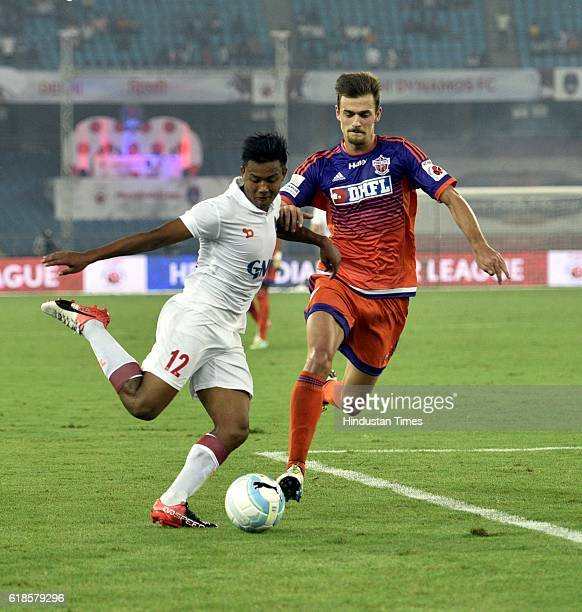 Milan Singh of Delhi Dynamos FC and Jonathan Lucca of FC Pune City in action during the India Super League football match on October 27 2016 in New...
