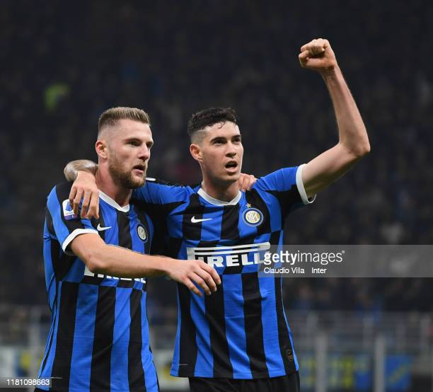 Milan Skriniar and Alessandro Bastoni of FC Internazionale celebrate at the end of the Serie A match between FC Internazionale and Hellas Verona at...