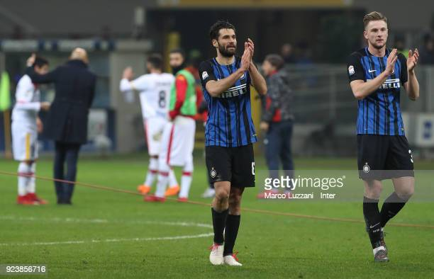 Milan Skriniar and Antonio Candreva of FC Internazonale celebrate the win with fans at the end of the during the serie A match between FC...