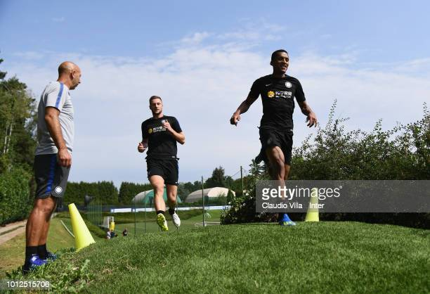 Milan Skriniar and Dalbert Henrique Chagas Estevão of FC Internazionale in action during the FC Internazionale training session at the club's...