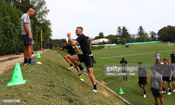 Milan Skriniar and Gabriele Zappa of FC Internazionale run during the FC Internazionale training session at the club's training ground Suning...