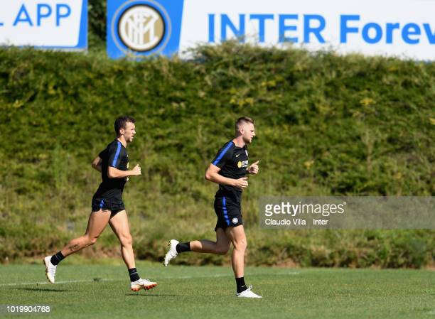 Milan Skriniar and Ivan Perisic of FC Internazionale in action during the FC Internazionale training session at the club's training ground Suning...