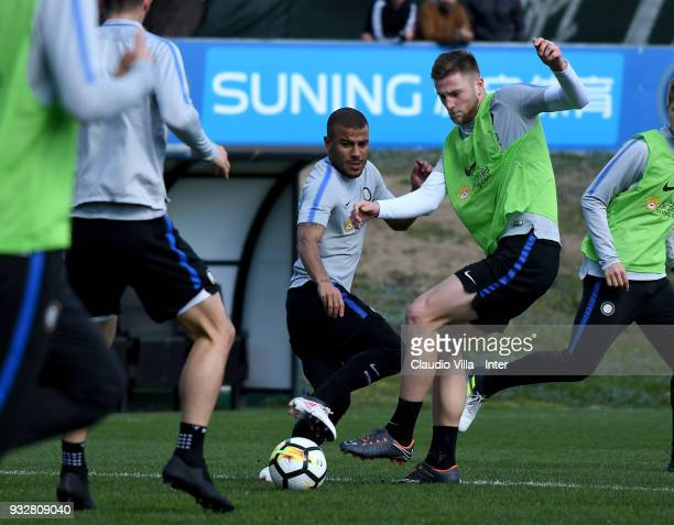 Milan Skriniar and Rafinha of FC Internazionale compete for the ball during the FC Internazionale training session at the club's training ground...