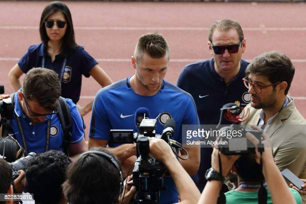 Milan Skriniar of FC Inter Milan gives a door stop interview during an International Champions Cup FC Inter Milan training session at Bishan Stadium...