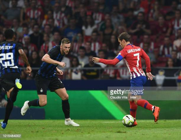 Milan Skriniar of FC Internazionale and Antoine Griezmann of Atletico Madrid compete for the ball during the International Champions Cup 2018 match...