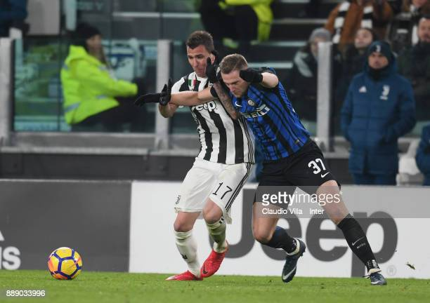 Milan Skriniar of FC Internazionale and Mario Mandzukic of Juventus FC compete for the ball during the Serie A match between Juventus and FC...