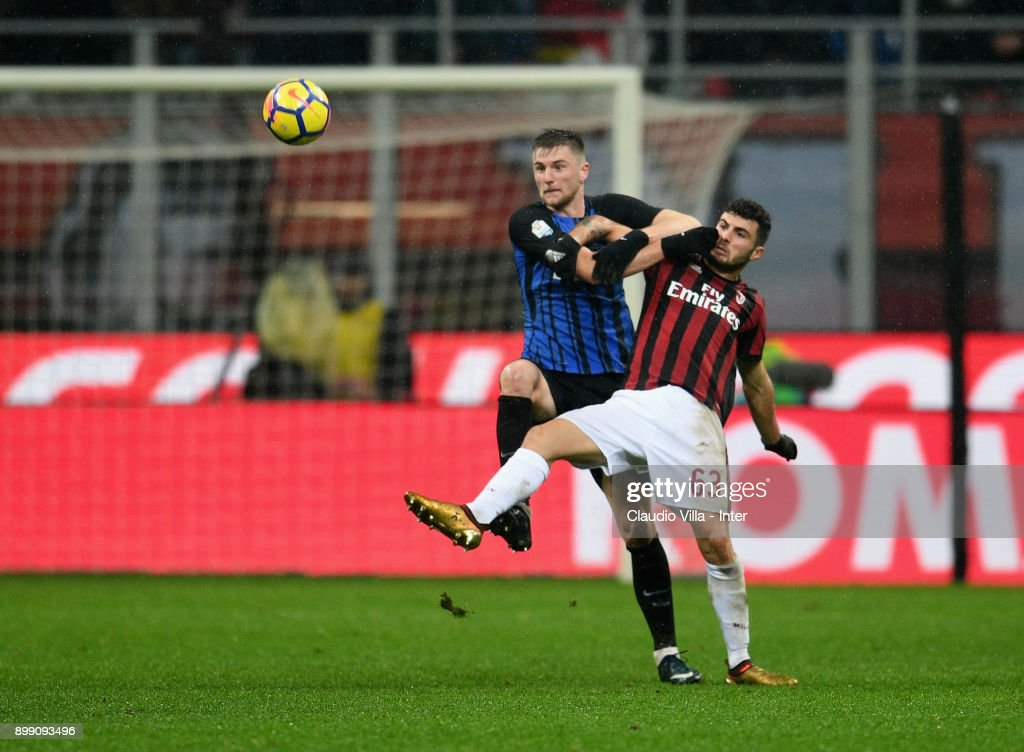 Milan Skriniar of FC Internazionale and Patrick Cutrone of AC Milan #63 compete for the ball during the TIM Cup match between AC Milan and FC Internazionale at Stadio Giuseppe Meazza on December 27, 2017 in Milan, Italy.