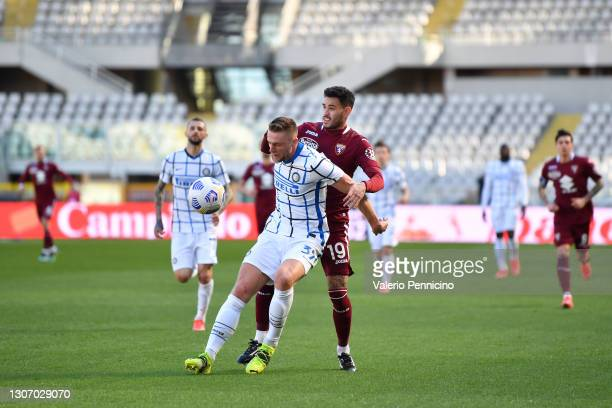 Milan Skriniar of FC Internazionale battles for possession with Antonio Sanabria of Torino FC during the Serie A match between Torino FC and FC...