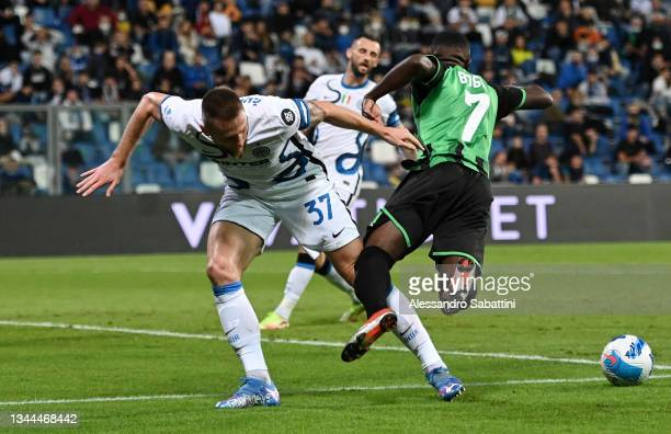 Milan Skriniar of FC Internazionale brings down Jeremie Boga of US Sassuolo to concede a penalty during the Serie A match between US Sassuolo v FC...