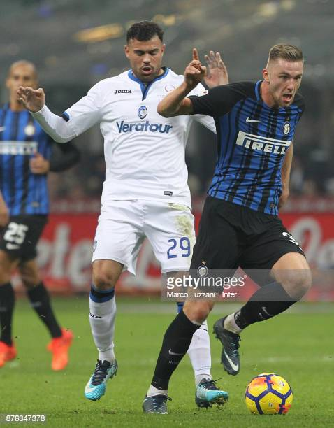 Milan Skriniar of FC Internazionale competes for the ball with Andrea Petagna of Atalanta BC during the Serie A match between FC Internazionale and...
