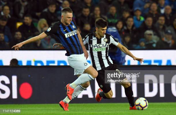 Milan Skriniar of FC Internazionale competes for the ball with Ignacio Pussetto of Udinese Calcio during the Serie A match between Udinese and FC...