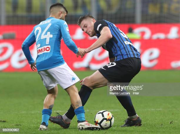Milan Skriniar of FC Internazionale competes for the ball with Lorenzo Insigne of SSC Napoli during the serie A match between FC Internazionale and...