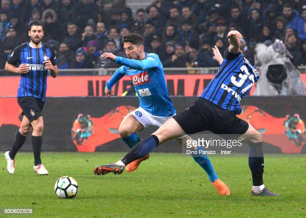 Milan Skriniar of FC Internazionale competese with Dries Mertens of SSC Napoli during the serie A match between FC Internazionale and SSC Napoli at...