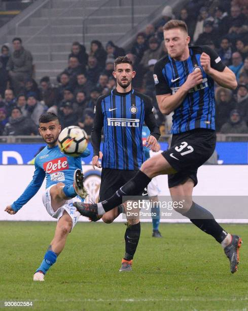 Milan Skriniar of FC Internazionale competese with Lorenzo Insigne of SSC Napoli during the serie A match between FC Internazionale and SSC Napoli at...
