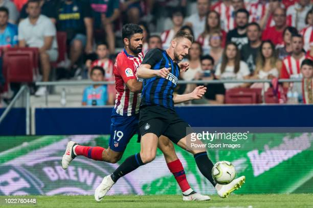 Milan Skriniar of FC Internazionale fights for the ball with Diego Costa of Atletico de Madrid during their International Champions Cup Europe 2018...