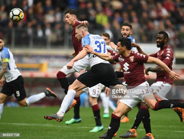 Milan Skriniar of FC Internazionale in action during the serie A match between Torino FC and FC Internazionale at Stadio Olimpico di Torino on April...