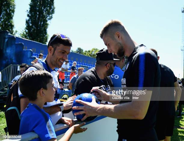Milan Skriniar of FC Internazionale interacts with fans during the FC Internazionale training session at the club's training ground Suning Training...