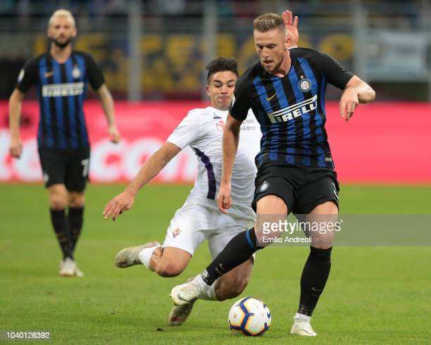 Milan Skriniar of FC Internazionale is challenged by Giovanni Simeone of ACF Fiorentina during the Serie A match between FC Internazionale and ACF...