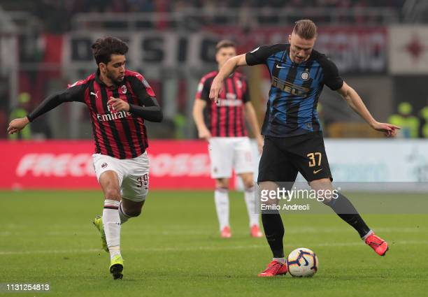 Milan Skriniar of FC Internazionale is challenged by Lucas Paqueta of AC Milan during the Serie A match between AC Milan and FC Internazionale at...