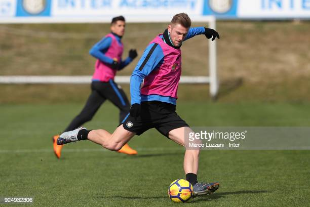 Milan Skriniar of FC Internazionale kicks a ball during the FC Internazionale training session at the club's training ground Suning Training Center...