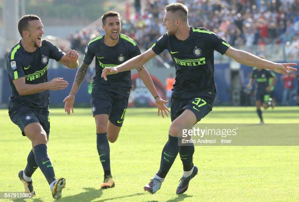 Milan Skriniar of FC Internazionale Milano celebrates with his teammate Ivan Perisic and Matias Vecino after scoring the opening goal during the...