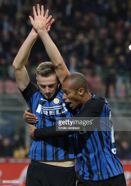 Milan Skriniar of FC Internazionale Milano celebrates with his teammate Joao Miranda de Souza Filho after scoring the opening goal during the Serie A...