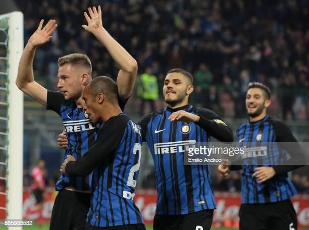 Milan Skriniar of FC Internazionale Milano celebrates with his teammates Mauro Emanuel Icardi and Joao Miranda de Souza Filho after scoring the...