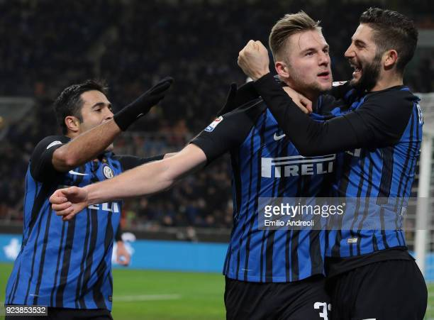Milan Skriniar of FC Internazionale Milano celebrates with his teammate Roberto Gagliardini after scoring the opening goal during the serie A match...
