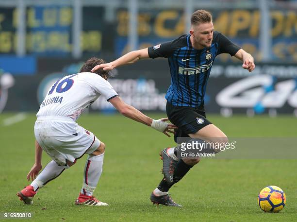Milan Skriniar of FC Internazionale Milano is challenged by Andrea Poli of Bologna FC during the serie A match between FC Internazionale and Bologna...