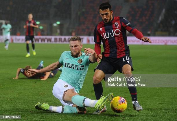 Milan Skriniar of FC Internazionale tackles Nicola Sansone of Bologna FC during the Serie A match between Bologna FC and FC Internazionale at Stadio...
