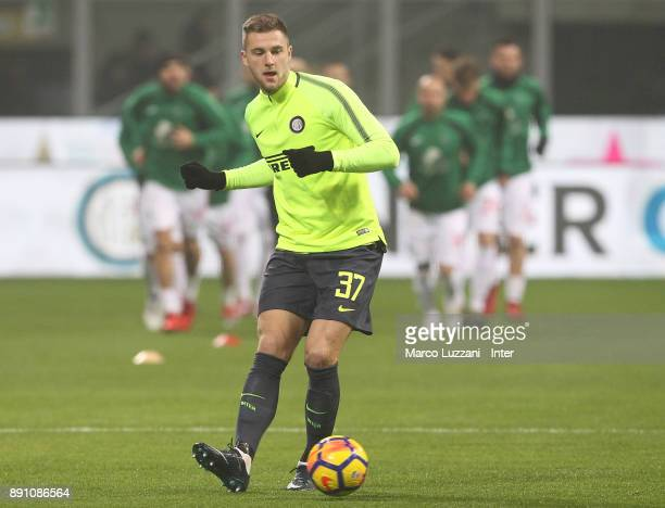 Milan Skriniar of FC Internazionale warms up ahead of the TIM Cup match between FC Internazionale and Pordenone at Stadio Giuseppe Meazza on December...