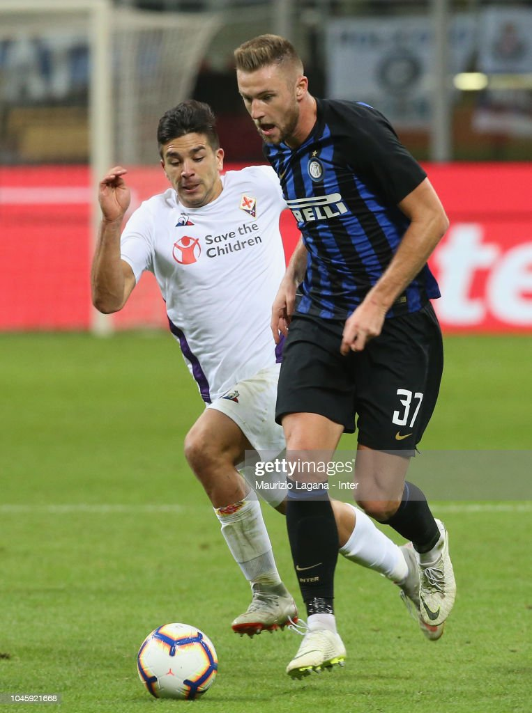 Milan Skriniar of Inter competes for the ball with ...