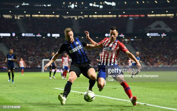 Milan Skriniar of Inter Milan is tackled by Nikola Kalinic of Atletico Madrid during the International Champions Cup 2018 match between Athletico...