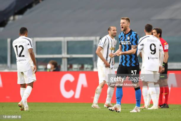 Milan Skriniar of Internazionale celebrates after team mate Romelu Lukaku's effort was given following a consultation with the VAR by referee...