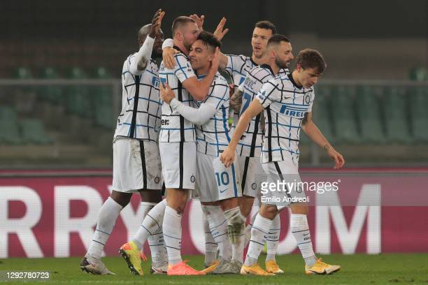 Milan Skriniar of Internazionale celebrates with Lautaro Martinez and team mates after scoring their sides second goal during the Serie A match...