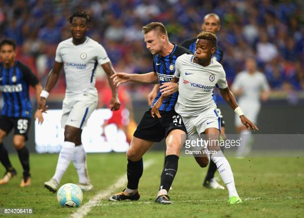 Milan Skriniar of Internazionale challenges Charly Musonda Jr of Chelsea during the International Champions Cup match between FC Internazionale and...