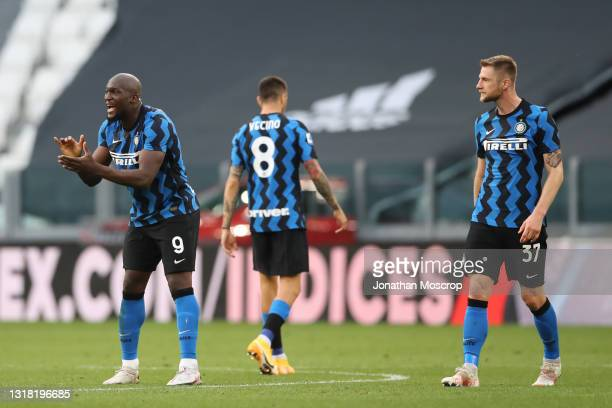 Milan Skriniar of Internazionale looks on as team mate Romelu Lukaku encourages his team mates after a goal was validated by the referee Gianpaolo...