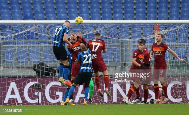 Milan Skriniar of Internazionale scores their side's first goal during the Serie A match between AS Roma and FC Internazionale at Stadio Olimpico on...