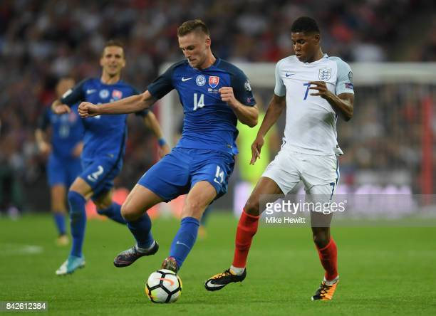 Milan Skriniar of Slovakia and Marcus Rashford of England battle for the ball during the FIFA 2018 World Cup Qualifier between England and Slovakia...