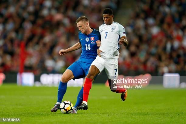 Milan Skriniar of Slovakia and Marcus Rashford of England during the FIFA 2018 World Cup Qualifier between England and Slovakia at Wembley Stadium on...