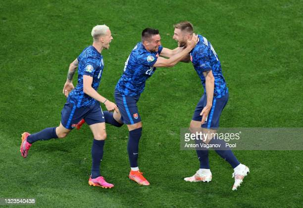 Milan Skriniar of Slovakia celebrates with Robert Mak after scoring their side's second goal during the UEFA Euro 2020 Championship Group E match...