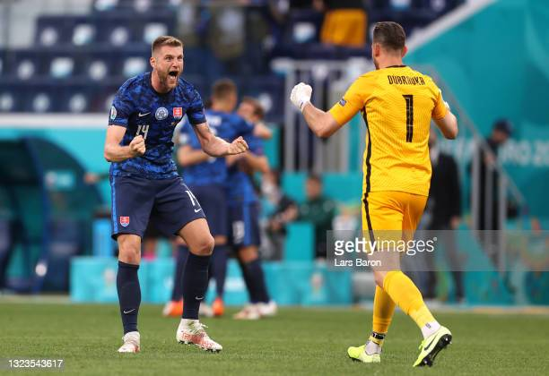Milan Skriniar of Slovakia celebrates with team mate Martin Dubravka after victory in the UEFA Euro 2020 Championship Group E match between Poland...