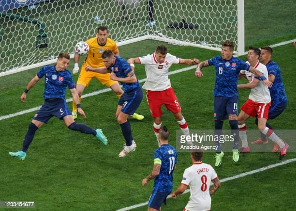 Milan Skriniar of Slovakia in action against Jan Bednarek of Poland during EURO 2020 Group E soccer match between Poland and Slovakia at Krestovsky...