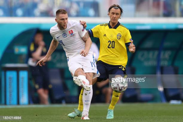Milan Skriniar of Slovakia makes a pass whilst under pressure from Kristoffer Olsson of Sweden during the UEFA Euro 2020 Championship Group E match...