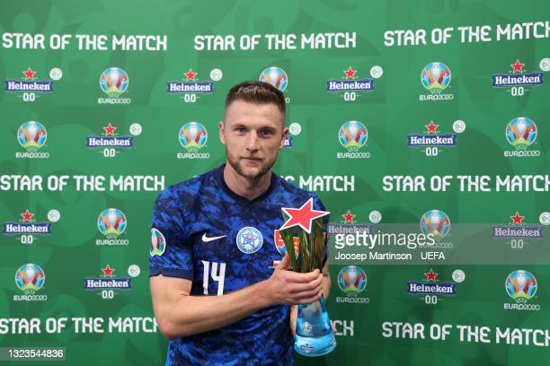 """Milan Skriniar of Slovakia poses for a photograph with their Heineken """"Star of the Match"""" award after the UEFA Euro 2020 Championship Group E match..."""