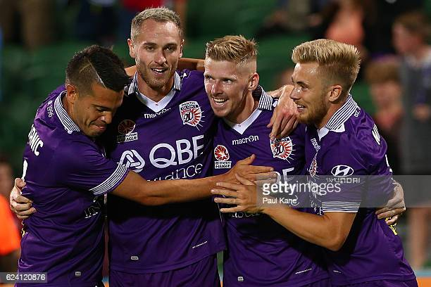 Milan Smiljanic Rostyn Griffiths Andy Keogh and Joseph Mills of the Glory celebrate a goal during the round seven ALeague match between the Perth...