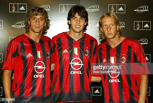 AC Milan soccer players Hernan Crespo Kaka and Massimo Ambrosini unveil their new soccer jersey at Macy's Herald Square July 30 2004 in New York City